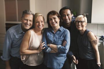 Portrait of happy multi-ethnic friends in kitchen