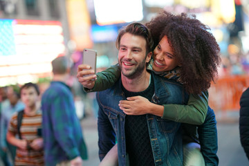 Couple at Times Square taking selfie picture