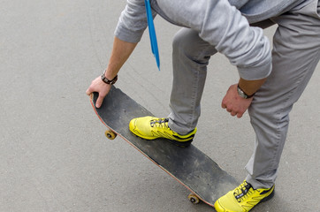 Young man with the skateboard