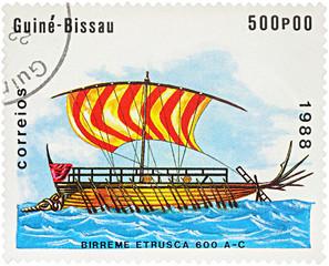 Ancient war ship - Bireme Etrusca on postage stamp