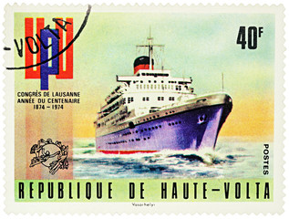 Old cruise ship on postage stamp
