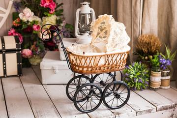 Doll's pram. Vintage doll stroller. Retro cart dolls