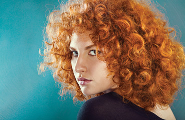 redhead sexy curly young woman