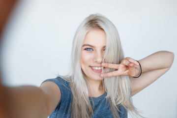smiling young girl making selfie photo
