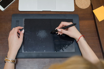Young woman using graphic tablet