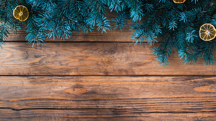 Christmas wooden background with fir tree. Copy space