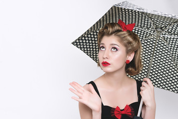 Beautiful young woman with pin-up make-up and hairstyle