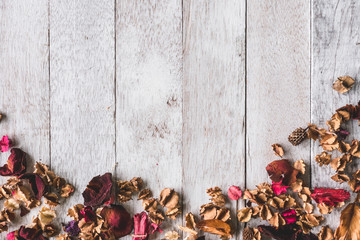 Top view of  Dried flowers on wooden table background.