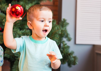 Cute happy little boy with christmas ball