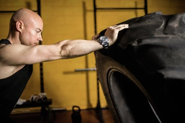 Thai boxer lifting heavy tyre