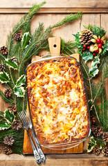 Christmas background with lasagna. Italian homemade family dish