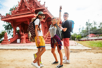 excited tourists at buddhist temple in thailand