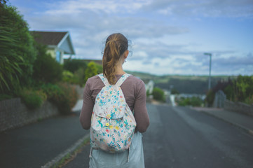 Young woman in the suburbs