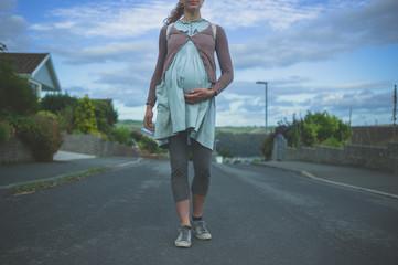 Pregnant woman in suburbia