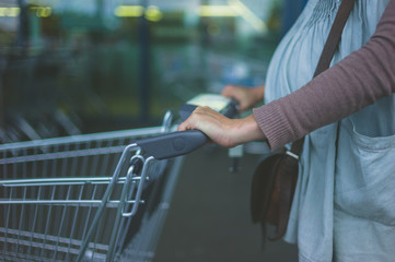 Pregnant woman with shopping trolley