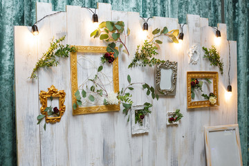vintage frames and flowers hanging on the wall.