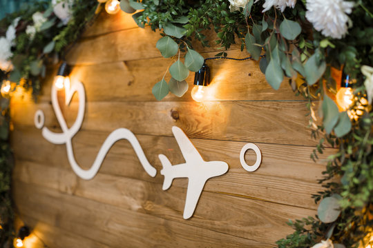 plane on wooden boards decorated with flowers. distance and lov