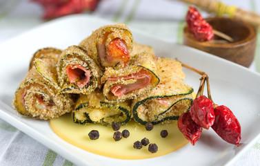 Zucchini rolls gratinated