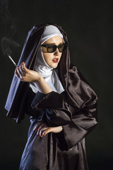 Portrait of a smoking young nun