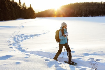 Winter hiking sport activity woman snowshoeing
