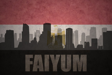 abstract silhouette of the city with text Faiyum at the vintage egyptian flag