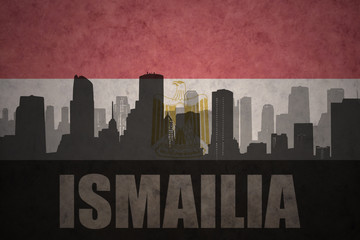 abstract silhouette of the city with text Ismailia at the vintage egyptian flag