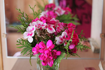 Pink flower stands in a vase