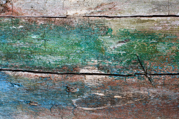 Cracked wooden texture. Hardwood pattern with green blue paint. macro view