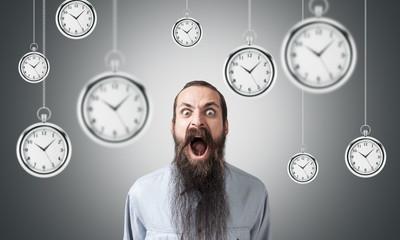 Shouting man and hanging clocks