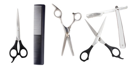 Comb with scissors and razor on a white background