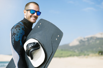 Portrait of handsome man kitesurfer.