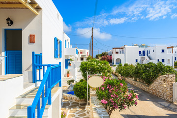 View of street with typical Greek houses in Naoussa town, Paros island, Greece