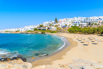 Fototapete - View of beautiful sea bay with beach in Naoussa town, Paros island, Greece