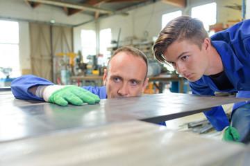 Engineers looking at their work