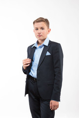 Boy teenager gentleman in a suit on a white background
