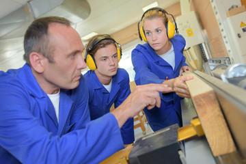 Female apprentice carpenter at work