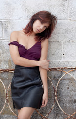 Sexy Woman Leaning Against Cinder Block Wall