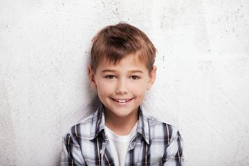 Portrait of little boy in studio.