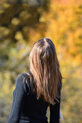 Long haired girl in autumn