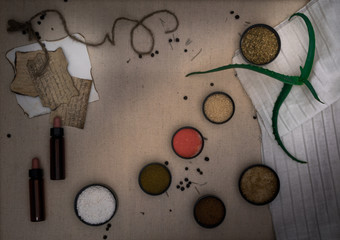 Alchemy Lab. dried herbs, salt, flasks, pipettes on canvas. top view