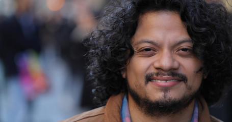 Latino hispanic man in city face portrait