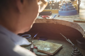 Craftswoman using blow torch in workshop
