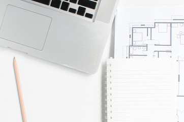 Computer and Blueprint Architecture on white desk