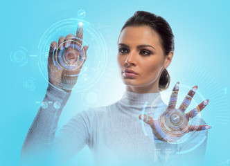 Future technology Virtual Holographic interface. Hi-tech Girl touching screen. Business Young lady working with virtual Graphics in futuristic office. Image isolated on blue background.
