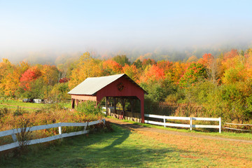 Old barn in beautiful Vermont autumn landscape.