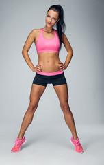 Full body portrait of athletic, sexy fitness female.