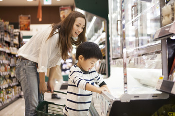 That boy is helping her with a supermarket