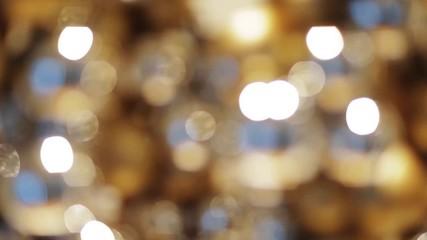 Fotobehang - blurred golden christmas lights bokeh