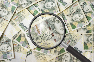 Czech money background with magnifying glass