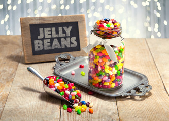 Colorful jelly Beans candy dessert table at a holiday event celebration party decorative decor